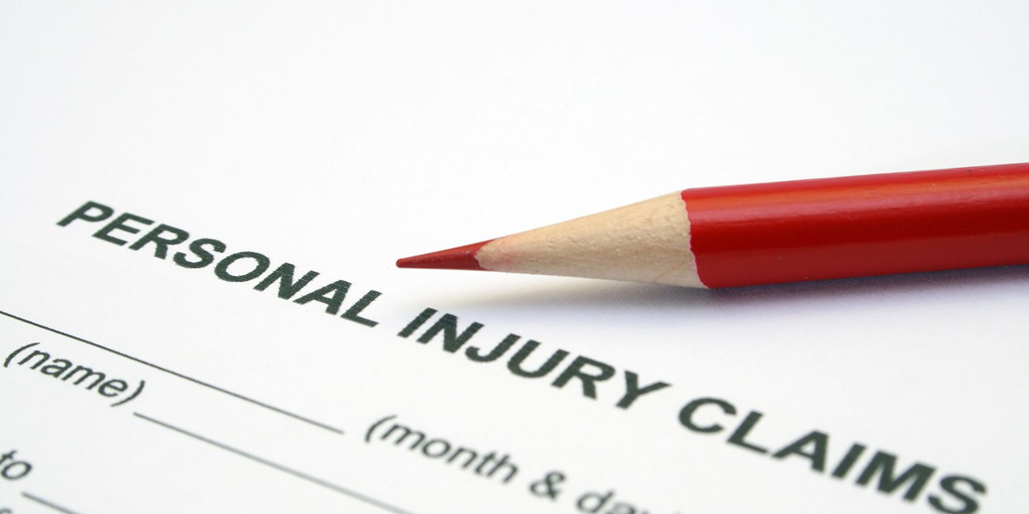 Close up of pencil on Personal injury claim